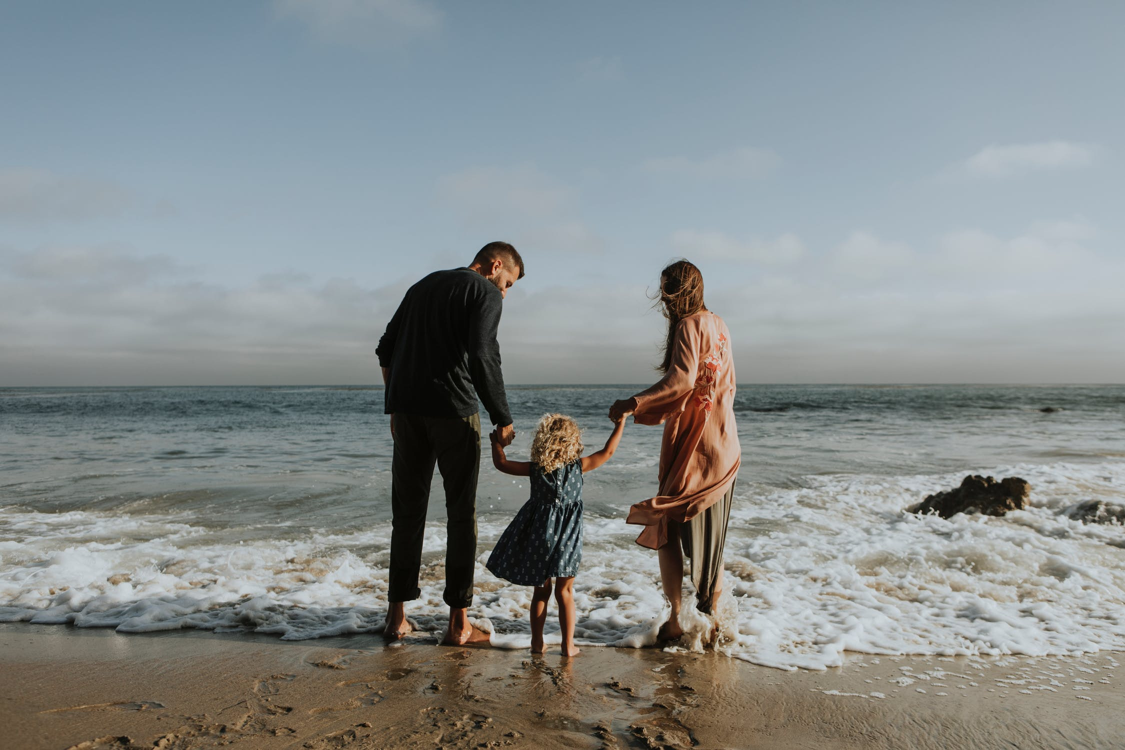 image of family on beach