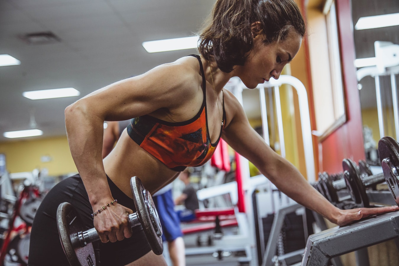image of woman lifting weights